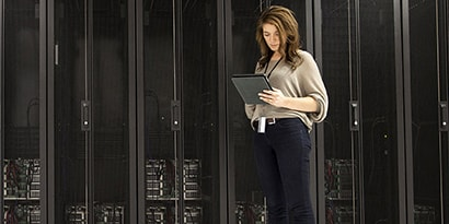 Mixed Race Businesswoman Using Tablet in Server Room