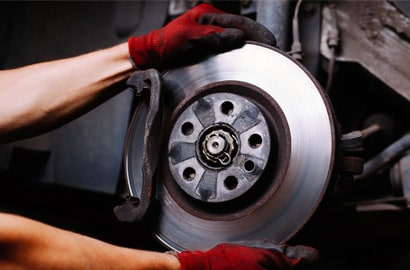 Man holding brake disc