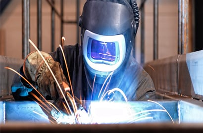welder with Speedglas helmet